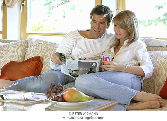 Living rooms, sofa, couple, magazine,  reading, together,   Series, 30-40 years, partnership, relationship, marriage, harmony, leisure time, togetherness