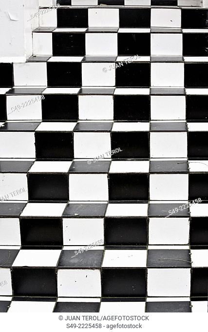 Black and white chequered stairs. London, England