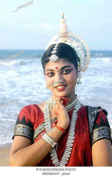 Dancer performing classical traditional odissi dance , Konarak , Orissa , India MR 736C