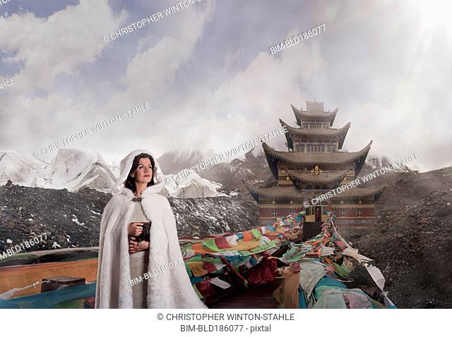Caucasian woman standing near monument, Xining, Qinghai, China