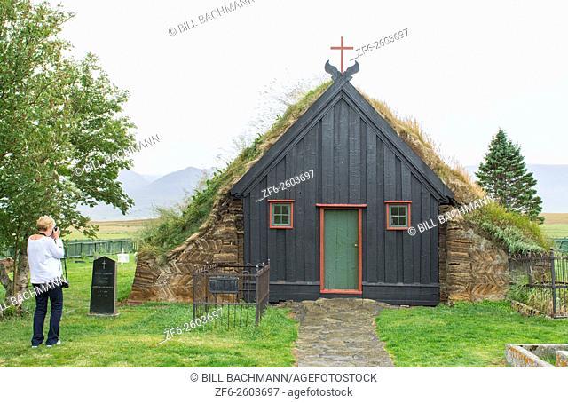 Iceland Vidimyrikirkia near Varmahlid in Northern Iceland Vidimyri Church turf Church with tourist taking photo