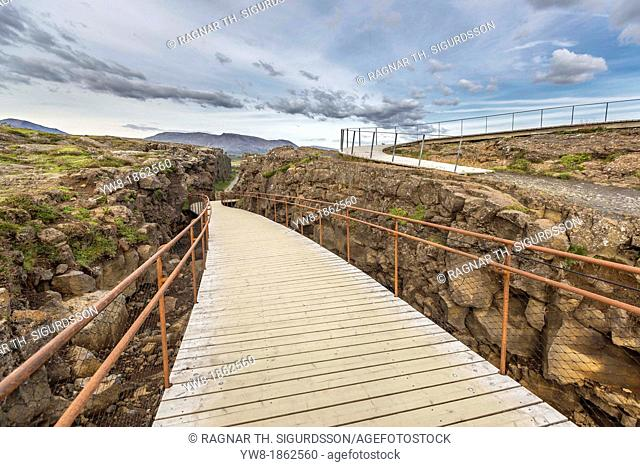 Walkway –Almannagja Fissure, Thingvellir National Park, Iceland  Almannagja is a large fault located within the active fissure of the Hengill volcanic system...