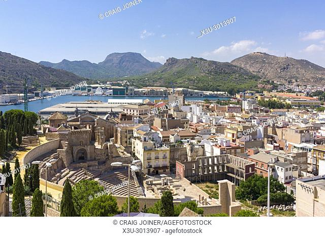 The Roman Theatre at Cartagena with the port beyond viewed from Torres Park, Spain