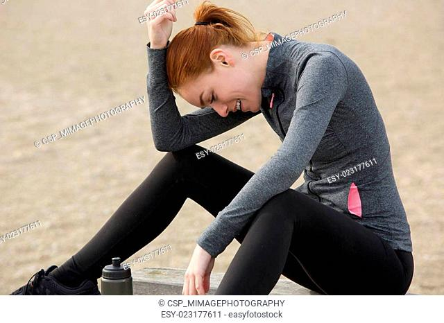 Close up portrait of a sports woman relaxing after workout
