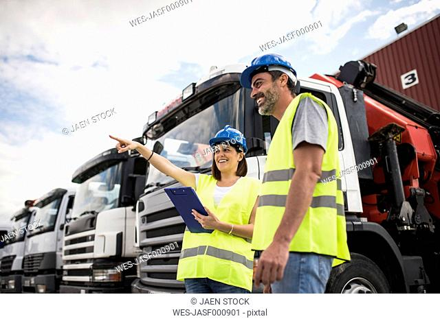Man and woman working at construction company