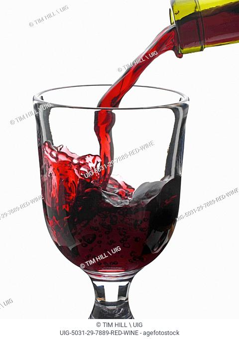 Red Wine Puring Into Glass
