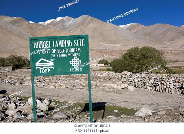 Sign indicating a campsite, site managed by eco-tourists company lead by a woman's group, Pangong Tso lake, Ladakh, India