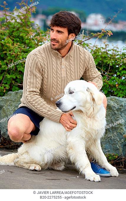 Man with dog. Rain. Hendaye. Aquitaine. France