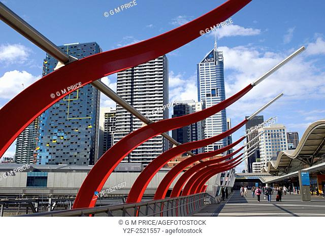 Designed concourse at Spencer Street station and Melbourne city skyline, Australia