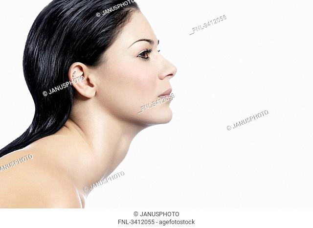 Young woman with black hair, profile