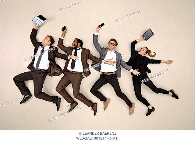 Business colleagues dancing with mobile devices