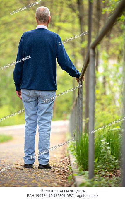 23 April 2019, Bavaria, Fürth: Wolfgang H., resident of an old people's home, walks in front of the facility. The 72-year-old is addicted to alcohol and is...