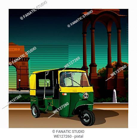 Auto rickshaw near a war memorial, India Gate, New Delhi, India