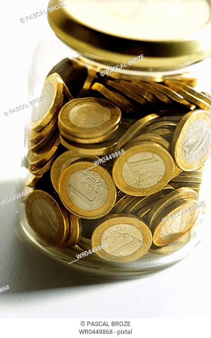 Close-up of a jar of European union coins