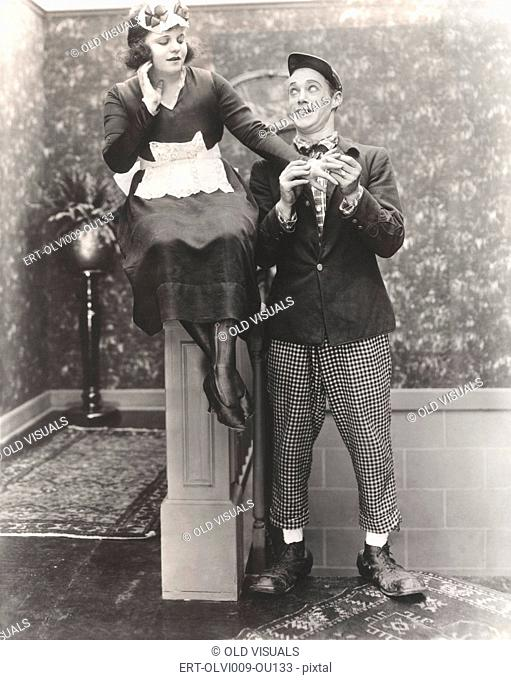 Man in clown shoes proposes to maid