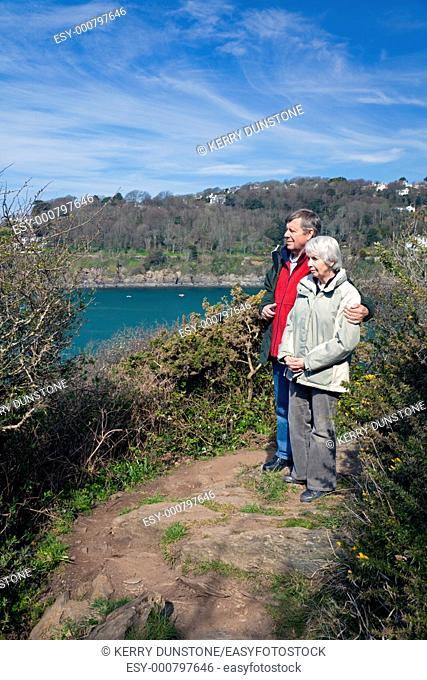 England Devon East Portlemouth Couple walking coast path at Biddlehead Point