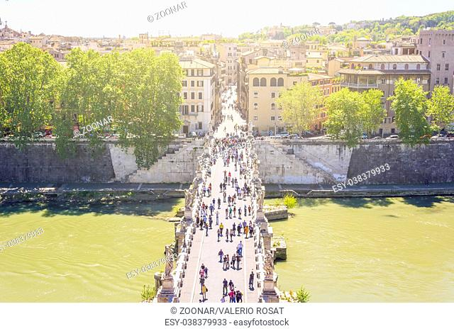 Saint Angel bridge over the river Tiber with tourists