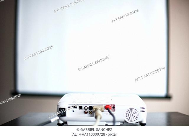Video projector and blank screen in office or classroom