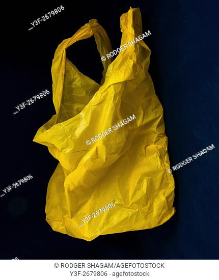A Used yellow plastic shopping packet