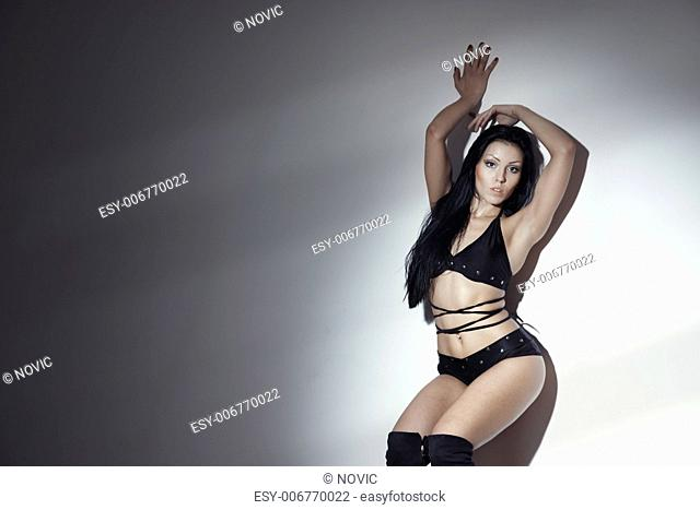 Woman performing seductive dance against the wall
