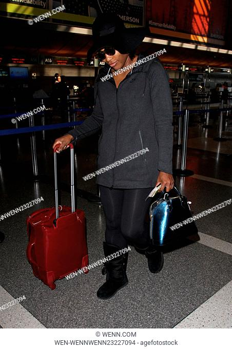 Serena Williams departs on a flight from Los Angeles International Airport (LAX). She wore a wide brimmed floppy hat and a baggy hoodie with Ugg style boots...