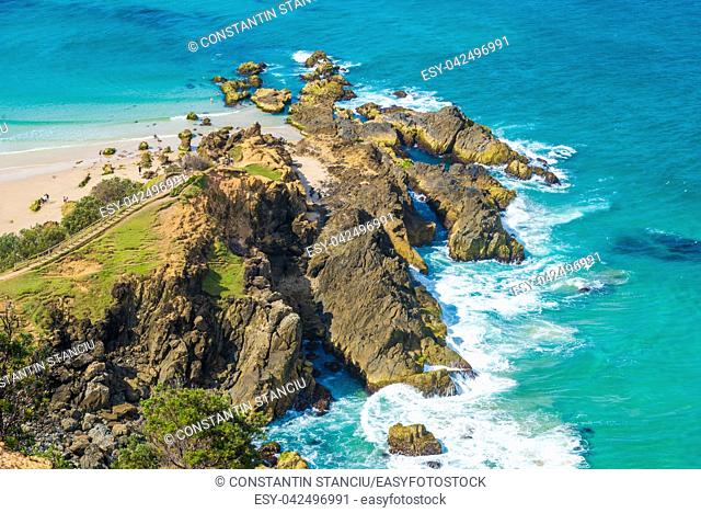 Ocean view over Cape Byron, the Most Easterly Point on the Australian Mainland with green turquoise water waves in Byron Bay, Australia