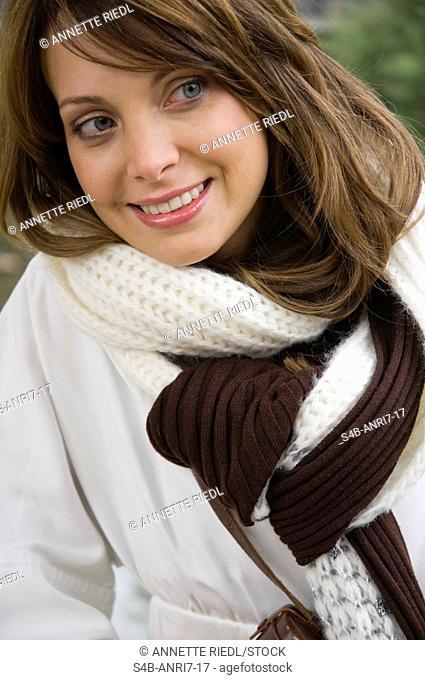 Smiling woman wearing scarf, Nuremberg, Bavaria, Germany