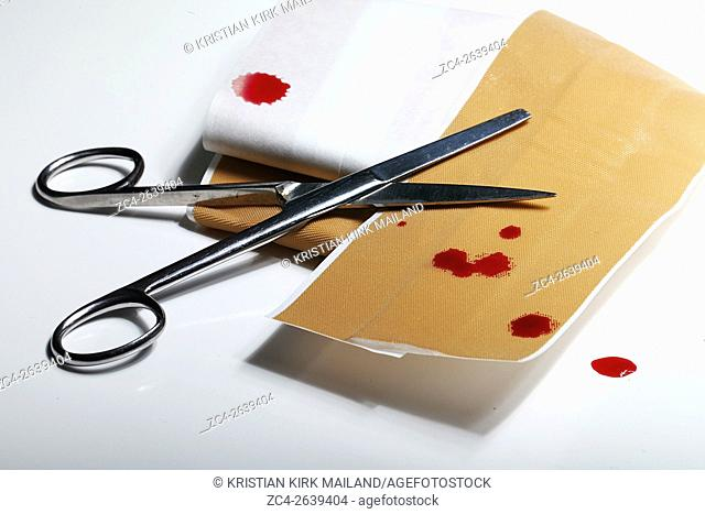 Blood spill, cutting pathes with scissors