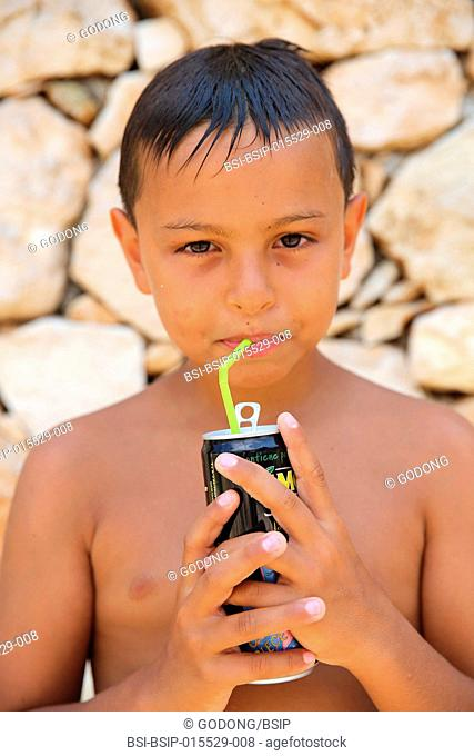 9-year-old boy drinking