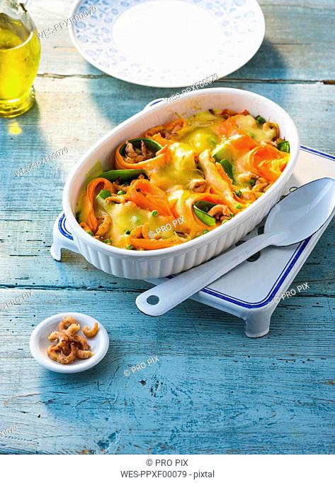 Casserole of North sea shrimps, carrots and snow peas