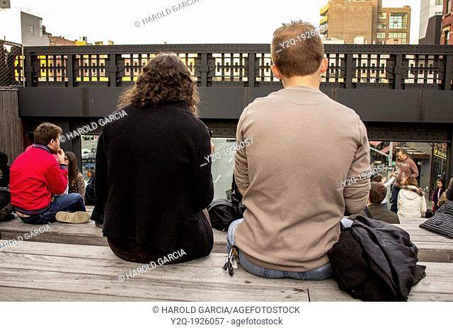 Man and woman at the high line park seating area 17th street New York City, New York  USA