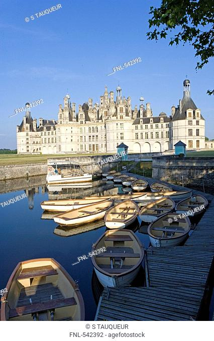 Boats in river in front of castle, Chateau De Chambord, Chambord, Loire-et-Cher, France