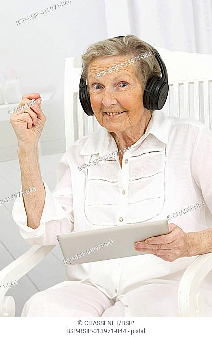 Senior woman using tablet computer