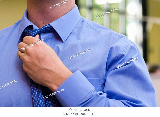 d954d23bf064 Adjusting shirt cuff Stock Photos and Images | age fotostock
