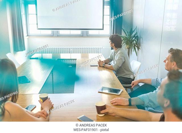 Business people sitting at conference table in office