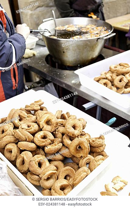 Frying donuts in the street, detail of a market, dessert, food for healthy life