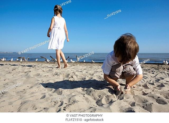 Artist's Choice: Brother and sister playing on beach, Erie Shores, Lake Erie, Ontario