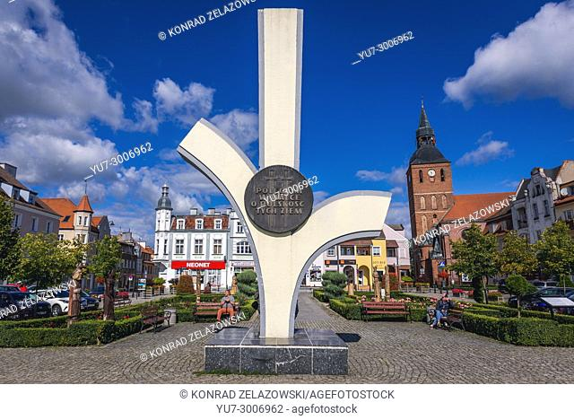 "Monument for """"those who died in a fight for Polish freedom"""" on market square of Biskupiec city in Warmian-Masurian Voivodeship of Poland"