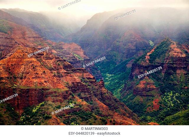 Landscape view of Waimea canyon during misty cloudy weather, Kauai, Hawaii, USA