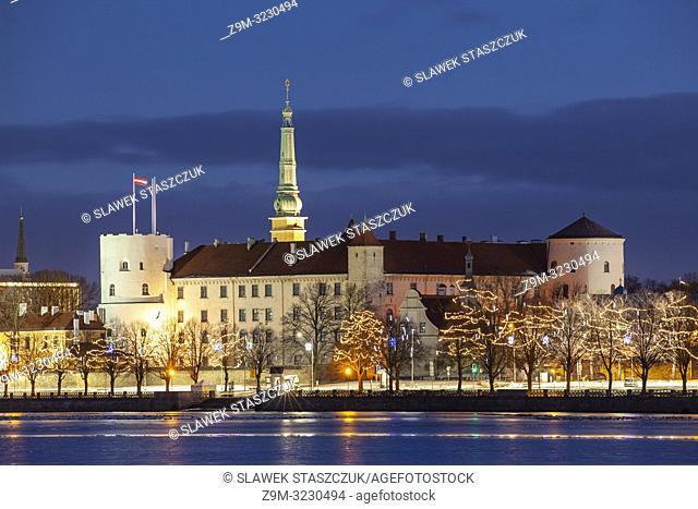 Riga castle seen across Daugava river at dawn, Latvia