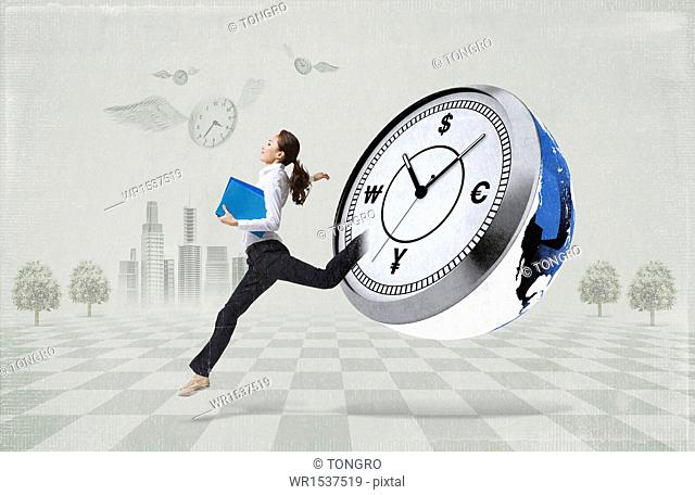 a business woman running next to a stop watch