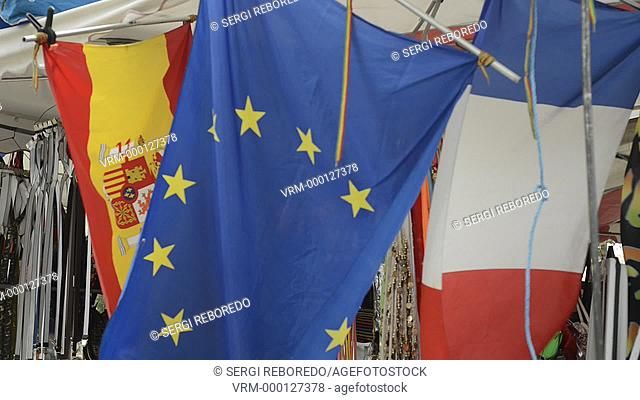 Spanish, french and european flag in the air. Narbonne Market. France. Shop selling books ahead of the market. This indoor market had a variety of fruit, fish