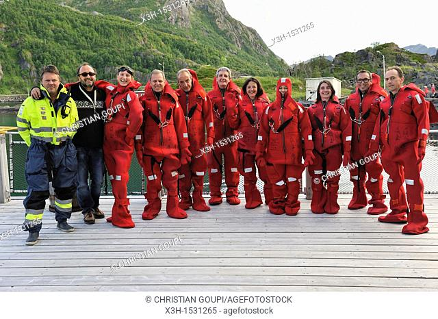 group ready for Artic bathing with survival suit, Senja island, County of Troms, Norway, Northern Europe