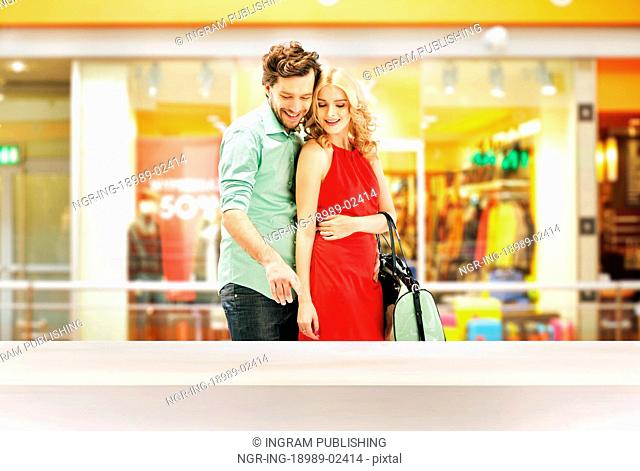 Smart couple standing in the shopping mall