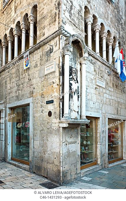 Statue beside clock tower, Split, Dalmatian coast, Dalmatia, Croatia