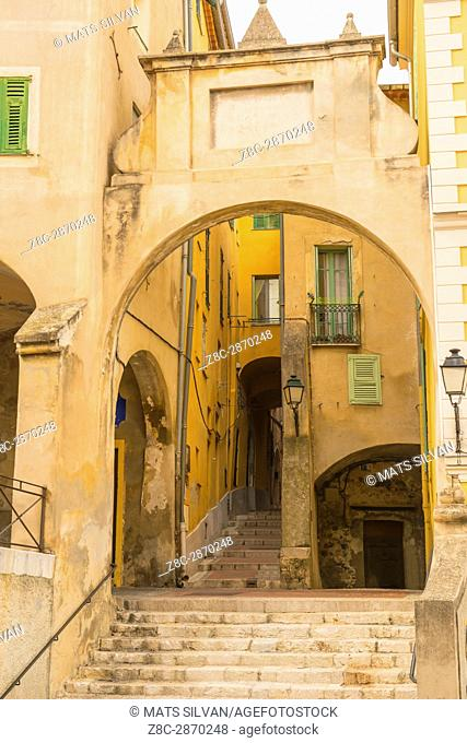 Narrow Street Alley and Staircase in a Sunny Day in Menton in Provence-Alpes-Côte d'Azur, France