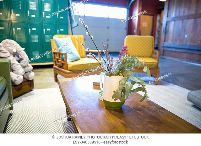 Yoga studio sitting area featuring vintage chairs and a relaxing space to sit and enjoy something to drink or eat