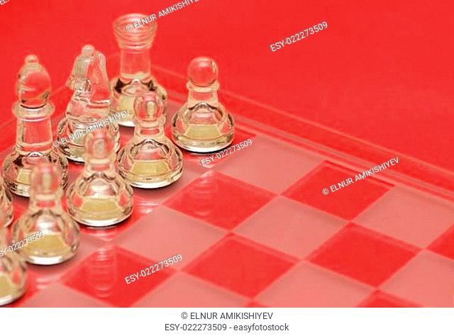 Chess figures on red background