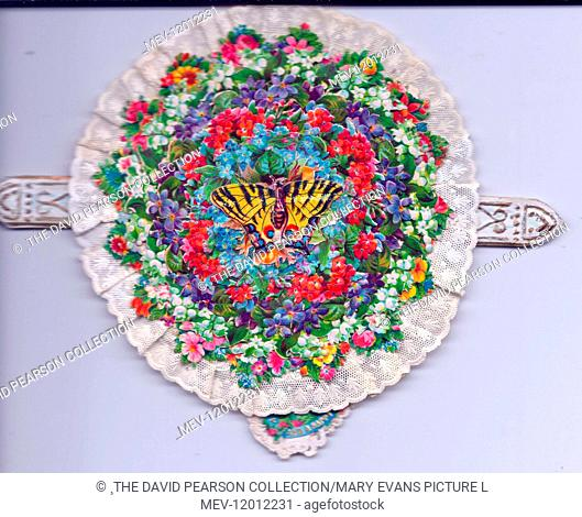Assorted flowers on a circular greetings card with a butterfly in the middle, a white lacy edging and two tab pulls