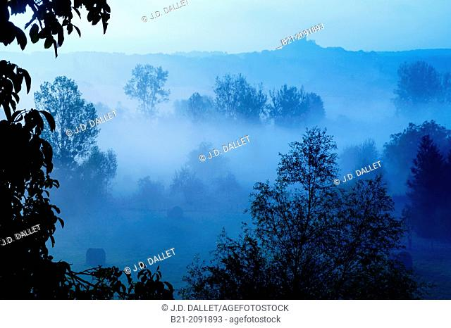 Medieval castle of Gurson in a foggy morning, Dordogne, Aquitaine, France